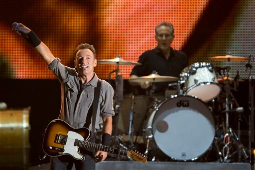 In this Sept. 22, 2013 file photo, Bruce Springsteen performs during the Rock in Rio music festival in Rio de Janeiro. Springsteen will headline the NCAA March Madness Music Festival next month in Dallas. (AP Photo/Felipe Dana, File)