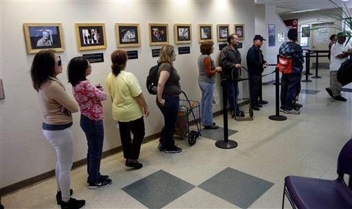 People line up at the food pantry at Sacred Heart Community Service on Friday, Feb. 21, 2014, in San Jose, Calif. (AP Photo/Marcio Jose Sanchez)