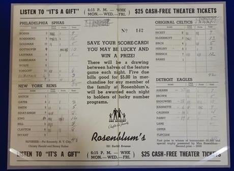 In this Feb. 19, 2014 photo, a Rosenblum tournament scorecard showing information for games between the Philladelphia Sphas vs. the Harlem Rens, and the Original Celtics vs. the Detroit Eagles.