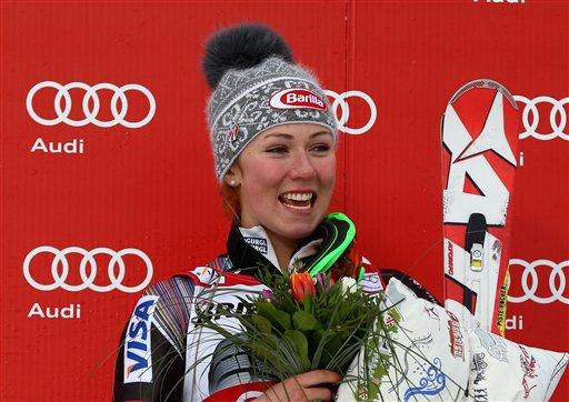 United States's Mikaela Schiffrin celebrates at finish line after winning an alpine ski women's World Cup slalom, in Are, Sweden, Saturday, March 8, 2014. (AP Photo/Alessandro Trovati)