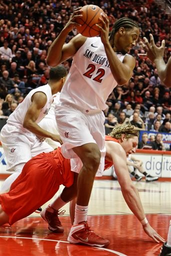 San Diego State forward Josh Davis pulls away a rebound from New Mexico forward Cameron Bairstow during a battle with during the first half of a NCAA college basketball game Saturday, March 8, 2014, in San Diego. (AP Photo/Lenny Ignelzi)