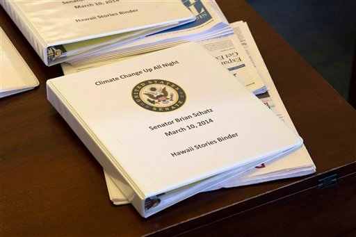 A binder containing climate change talking points and information for Sen. Brian Schatz, D-Hawaii, sits on a desk before a meeting of the Senate Climate Action Task Force prior to taking to the Senate Floor all night to urge action on climate change.