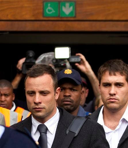Oscar Pistorius, left, with unidentified man leaves the high court in Pretoria, South Africa, Tuesday, March 11, 2014.