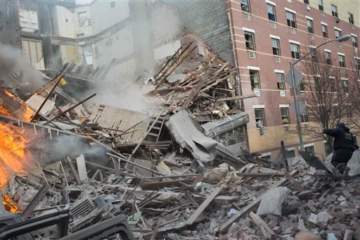 Emergency workers respond to the scene of an explosion that leveled two apartment buildings in the East Harlem neighborhood of New York, Wednesday, March 12, 2014. (AP Photo/Jeremy Sailing)