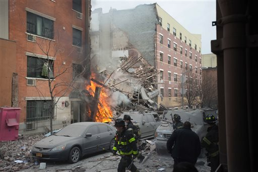 Firefighters work the scene of an explosion that leveled two apartment buildings in the East Harlem neighborhood of New York, Wednesday, March 12, 2014. (AP)