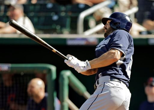 San Diego Padres' Xavier Nady watches his solo home run off Cleveland Indians relief pitcher Marc Rzepczynski in the fifth inning of a spring exhibition baseball game on Wednesday, March 12, 2014, in Goodyear, Ariz. (AP Photo/Mark Duncan)