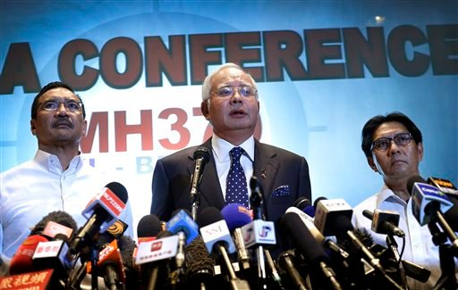 Najib said Saturday that investigators believe the missing Malaysian airliner's communications were deliberately disabled, that it turned back from its flight to Beijing and flew for more than seven hours. (AP Photo/Wong Maye-E)
