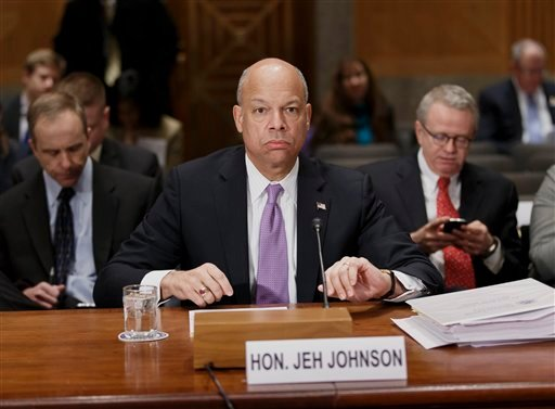 Homeland Security Secretary Jeh Johnson prepares to testify on Capitol Hill in Washington, Thursday, March 13, 2014, to outline President Barack Obama's FY2015 budget requests to the Senate Homeland Security and Governmental Affairs Committee.