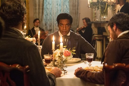 "In this July 18, 2012, film publicity image released by Fox Searchlight, Chiwetel Ejiofor portrays Solomon Northup in a scene from ""12 Years A Slave."""