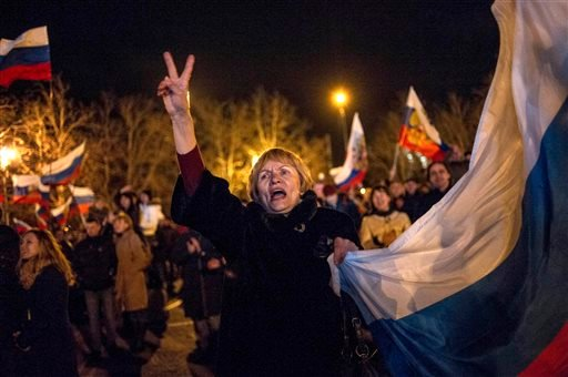 Pro-Russian people celebrate in the central square in Sevastopol, Ukraine, late Sunday, March 16, 2014.