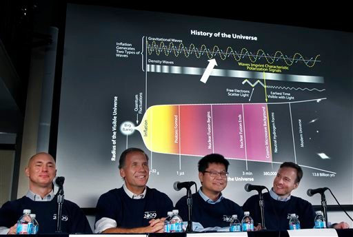 Scientists, from left, Clem Pryke, Jamie Bock, Chao-Lin Kuo and John Kovac smile during a news conference at the Harvard-Smithsonian Center for Astrophysics in Cambridge, Mass., Monday, March 17, 2014. (AP)