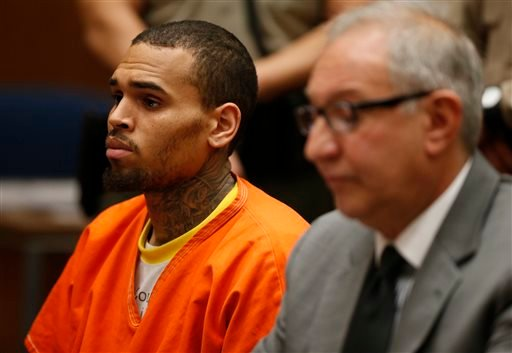 R&B singer Chris Brown, left, appears in Los Angeles Superior Court with his attorney Mark Geragos, on Monday, March 17, 2014.