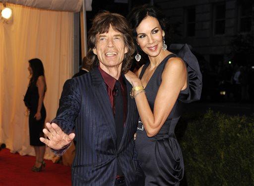 This May 7, 2012 file photo shows singer Mick Jagger, left, and L'Wren Scott at the Metropolitan Museum of Art Costume Institute gala benefit, celebrating Elsa Schiaparelli and Miuccia Prada, in New York.