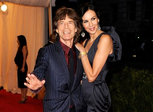 This May 7, 2012 file photo shows singer Mick Jagger, left, and L'Wren Scott at the Metropolitan Museum of Art Costume Institute gala benefit, celebrating Elsa Schiaparelli and Miuccia Prada, in New York.