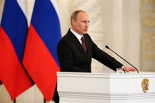 Russian President Vladimir Putin addresses the Federal Assembly in the Kremlin in Moscow, Tuesday, March 18, 2014.