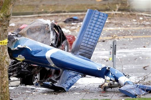The wreckage of a news helicopter sits on a city street after crashing Tuesday, March 18, 2014, in Seattle. (AP)