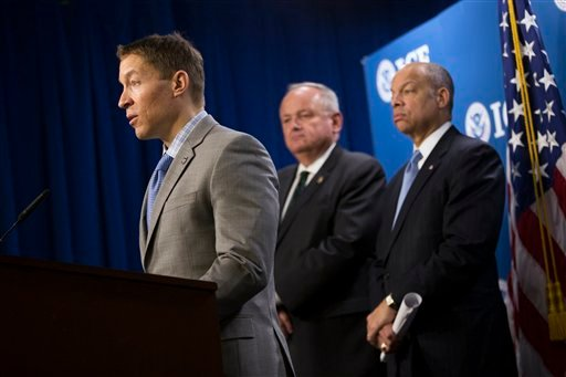 US Immigration and Customs Enforcement Deputy Director Daniel Ragsdale, left, accompanied by US Customs and Border Protection Deputy Commissioner Thomas S. Winkowski, center, and Homeland Security Secretary Jeh Johnson speaks during a news conference.