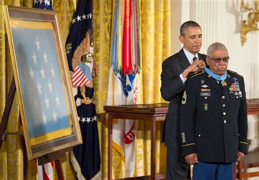 President Barack Obama awards Army Staff Sgt. Melvin Morris the Medal of Honor during a ceremony in the East Room of the White House in Washington, Tuesday, March 18, 2014. (AP)