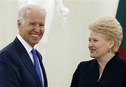 Vice President Joe Biden, left, and Lithuania's President Dalia Grybauskaite speak prior to their meeting at the Presidential Palace in Vilnius, Lithuania, Wednesday, March 19, 2014. (AP Photo/Mindaugas Kulbis)