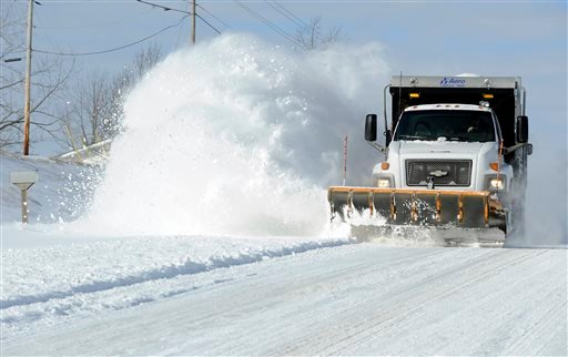In this march 3, 2013 file photo a state road plow kicks up a cloud of snow while clearing U.S. Highway 62 in Baxter County, Ark. (AP Photo/The Baxter Bulletin, Kevin Pieper, File)