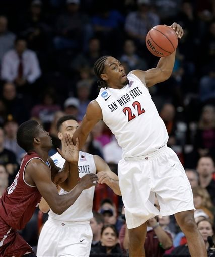 San Diego State's Josh Davis (22) reaches for a loose ball against New Mexico State in the first half during a second-round game of the NCAA men's college basketball tournament in Spokane, Wash., Thursday, March 20, 2014. (AP Photo/Elaine Thompson)