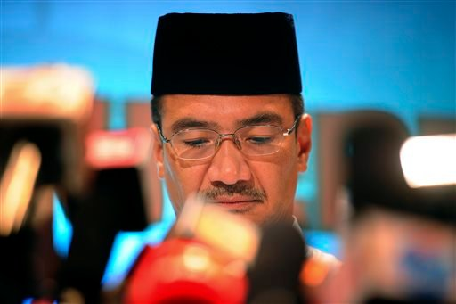 Malaysia's acting Transport Minister Hishammuddin Hussein pauses in between questions during a press conference for the missing Malaysia Airline, MH370 at a hotel in Sepang, outside Kuala Lumpur, Malaysia, Friday, March 21, 2014.