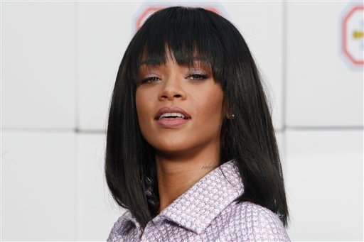 In this Tuesday, March 4, 2014 file photo, singer Rihanna poses as she arrives to Chanel's ready to wear fall/winter 2014-2015 fashion collection presented in Paris.