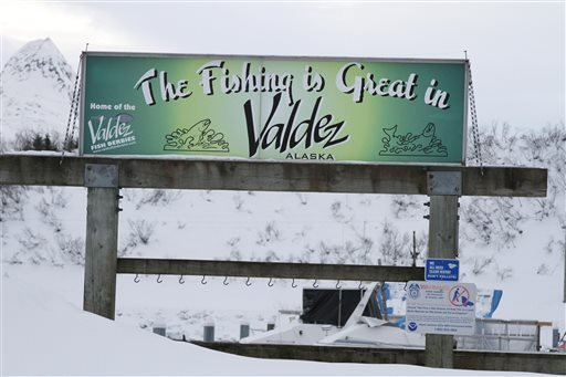 In this photo taken Feb. 26, 2014, is a sign hanging outside the small boat harbor in Valdez, Alaska.