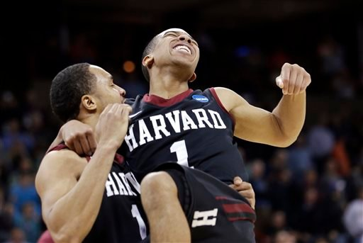 Harvard's Siyani Chambers, right, leaps into the arms of teammate Brandyn Curry after the team beat Cincinnati in the second round of the NCAA college basketball tournament in Spokane, Wash., Thursday, March 20, 2014. Harvard won 61-57. (AP Photo)