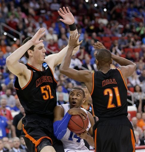 Duke guard Rasheed Sulaimon (14) works between Mercer's Daniel Coursey (52) and Langston Hall (21)during the second half of an NCAA college basketball second-round game, Friday, March 21, 2014, in Raleigh, N.C. (AP Photo/Chuck Burton)