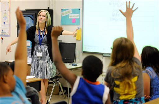In this Oct. 1, 2013, file photo, Amy Lawson, a fifth-grade teacher at Silver Lake Elementary School in Middletown, Del., teaches an English language arts lesson.