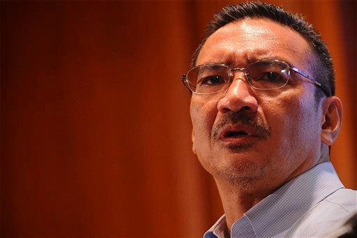 Malaysian Defense Minister Hishammuddin Hussein answers a question of a journalist during a press conference at a hotel in Sepang, Malaysia, Saturday, March 22, 2014.