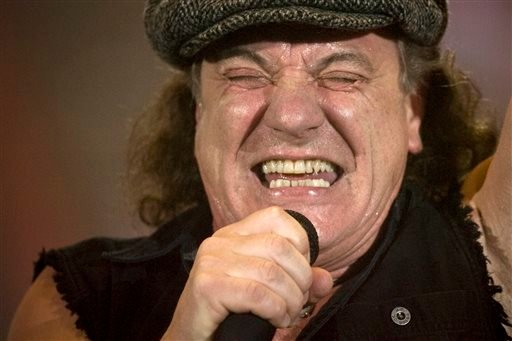Brian Johnson, lead singer of Australian rock band AC/DC, performs during a concert at the Hallestadion in Zurich, Switzerland, in this April 6, 2009 file photo. (AP Photo/KEYSTONE/Ennio Leanza, File)
