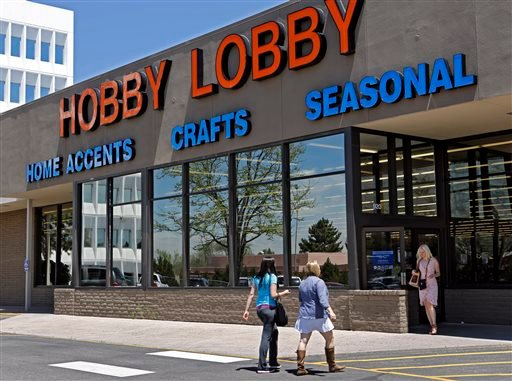 In this May 22, 2013, customers enter and exit a Hobby Lobby store in Denver.