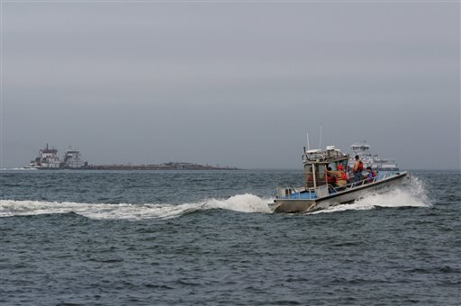 A response boat heads to the scene of a collision between a ship and barge in the ship channel near the Texas City Dike on Saturday, March 22, 2014.