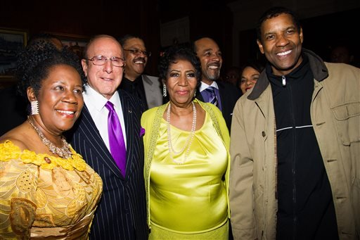 From left, Rep. Sheila Jackson Lee, Clive Davis, Aretha Franklin and Denzel Washington attend Aretha's 72nd birthday celebration on Saturday, March 22, 2014 in New York. (Photo by Charles Sykes/Invision/AP)