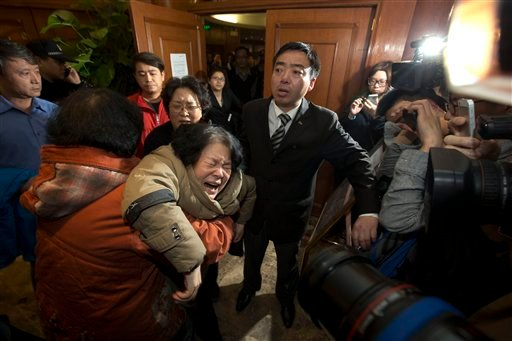 A relative of one of the Chinese passengers aboard the Malaysia Airlines, MH370 collapses in grief after being told of the latest news in Beijing, China, Monday, March 24, 2014. (AP)