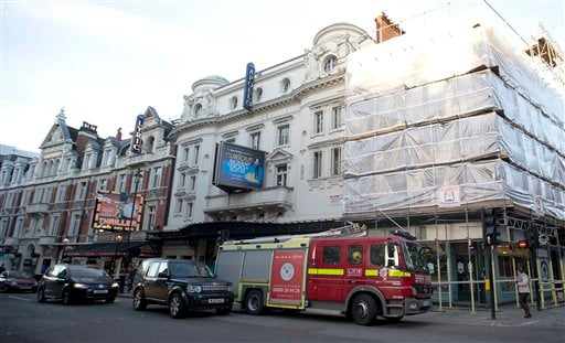 In this Friday, Dec. 20, 2013 file photo, a fire brigade truck waits outside The Apollo Theatre in London.
