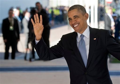 U.S. President Barack Obama waves as he arrives on the first day of the two-day Nuclear Security Summit (NSS) in The Hague, Netherlands, Monday, March 24, 2014. (AP Photo/Marco de Swart, POOL)
