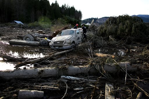Search and rescue personnel continue working the area of Saturday's mudslide, Monday, March 24, 2014, near Oso, Wash.