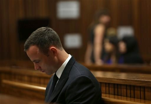 Oscar Pistorius sits in the dock in court of his murder trial in Pretoria, South Africa, Tuesday, March 25, 2014.