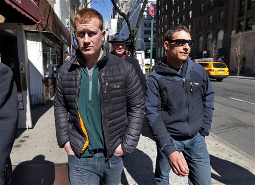 James Brady, left, and Andrew Rossig, right, two parachutists who jumped from One World Trader Center in September 2013, are accompanied by attorney Timothy Parlatore to surrender to police, in New York, Monday, March 24, 2014. (AP)