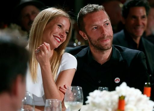 FILE - This Jan. 11, 2014 file photo shows actress Gwyneth Paltrow, left, and her husband, singer Chris Martin at the 3rd Annual Sean Penn & Friends Help Haiti Home Gala in Beverly Hills, Calif. (AP)