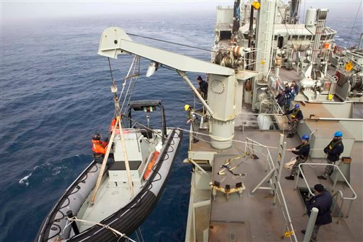 March 23, 2014 photo provided by the Australian Department of Defense, an inflatable boat is launched from HMAS Success during the search in the southern Indian Ocean for signs of the missing Malaysia Airlines Flight MH370. (AP Photo/ADF, James Whittle)