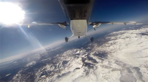Scientists from NASA's Jet Propulsion Laboratory fly over the Tuolumne River Basin of California's Sierra Nevada mountain range in a de Havilland Twin Otter plane to measure the snowpack on Sunday, March 23, 2014. (AP Photo/Haven Daley)