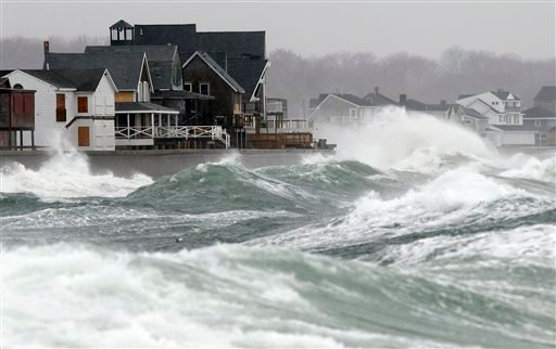 Wind-driven waves come ashore in Scituate, Mass., Wednesday, March 26, 2014. (AP Photo/Michael Dwyer)