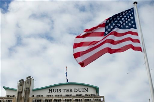 The U.S. flag flies outside Hotel Huis ter Duin, the hotel where President Barack Obama stayed Monday night, in Noordwijk, western Netherlands, Wednesday March 26, 2014. (AP)
