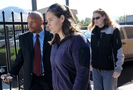FILE - Jordan Linn Graham, center, leaves the federal courthouse, in this Oct. 4, 2013 file photo taken in Missoula, Mont. (AP)