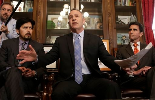 State Senate President Pro Tem Darrell Steinberg, center, D-Sacramento, calls for Sen. Leland Yee, D-San Francisco, to resign his seat in the wake of his arrest on federal corruption and firearm charges, during a news conference in Sacramento, Calif. (AP)