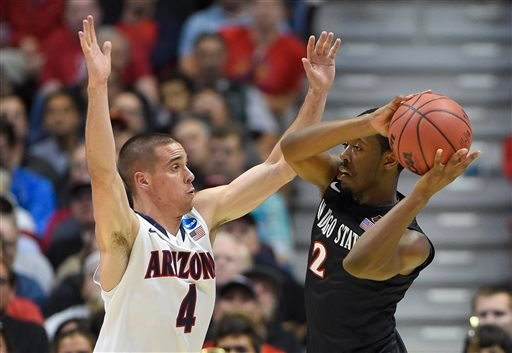 San Diego State guard Xavier Thames (2) looks to pass around Arizona guard T.J. McConnell (4) during the first half in a regional semifinal of the NCAA men's college basketball tournament March 27, 2014, in Anaheim.(AP Photo/Mark J. Terrill)
